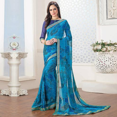 Desirable Blue Colored Casual Floral Printed Georgette Saree