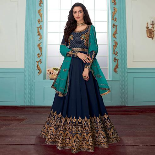 Glowing Navy Blue Colored Party Wear Floral Embroidered Georgette Anarkali Suit
