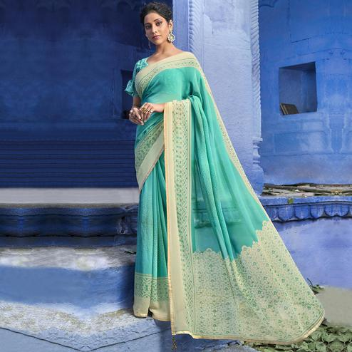 Trendy Sky Blue Colored Casual Wear Printed Georgette Saree