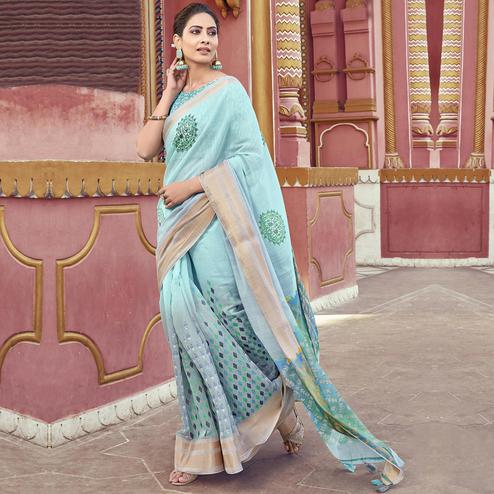 Graceful Sky Blue Colored Festive Wear Printed Cotton Saree With Tassels