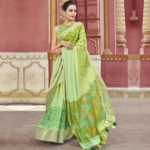 Charming Green Colored Festive Wear Printed Cotton Saree With Tassels