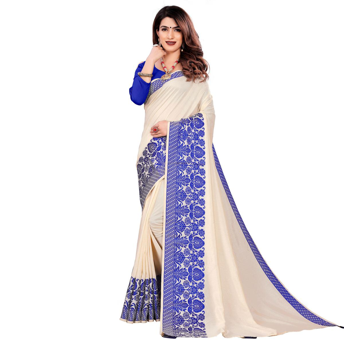 Intricate Cream Colored Festive Wear Woven Art Silk Saree With Tassels