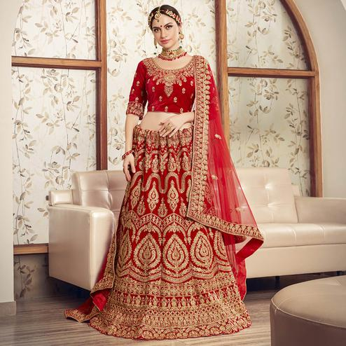 Demanding Red Colored Wedding Wear Embroidered Velvet Lehenga Choli