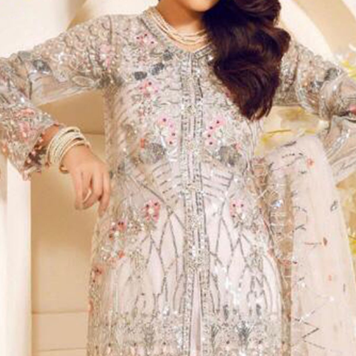 Adorning White Colored Partywear Embroidered Netted Suit