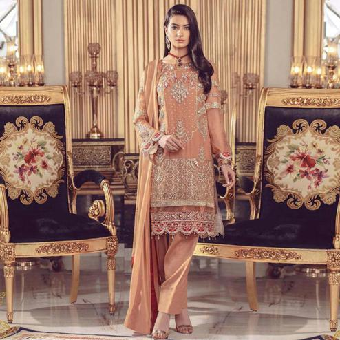 Pleasant Dark Peach Colored Partywear Embroidered Georgette Suit