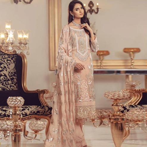 Glowing Peach Colored Partywear Embroidered Georgette Palazzo Suit