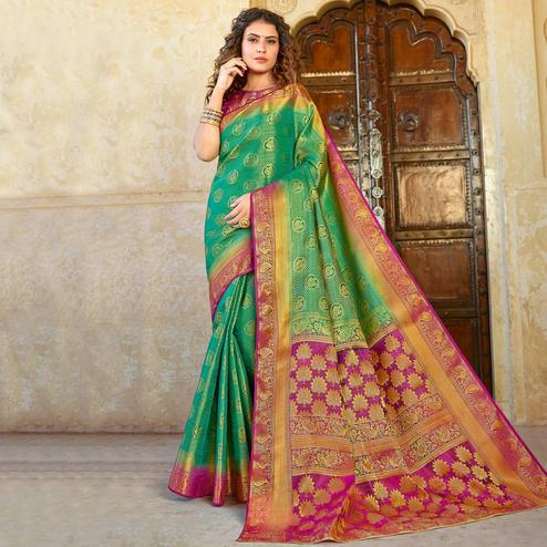 Glorious Green Colored Festive Wear Woven Silk Saree
