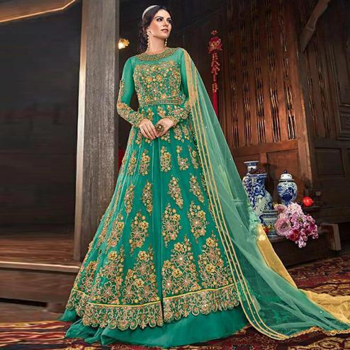 Demanding Turquoise Green Colored Partywear Embroidered Netted Lehenga Anarkali