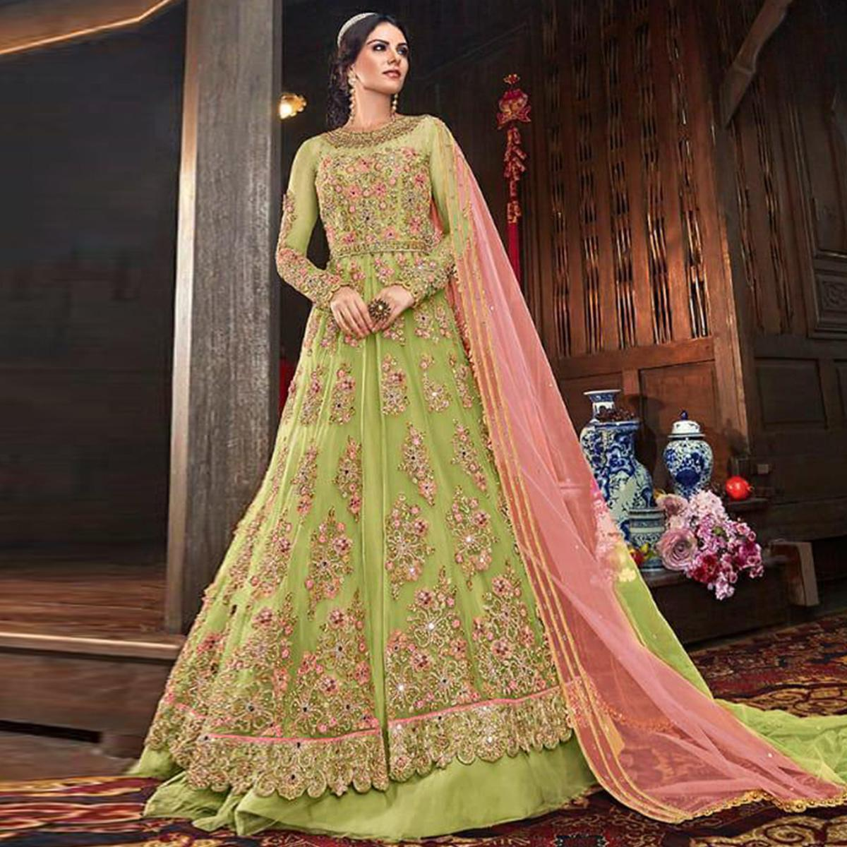 Refreshing Green Colored Partywear Embroidered Netted Lehenga Anarkali