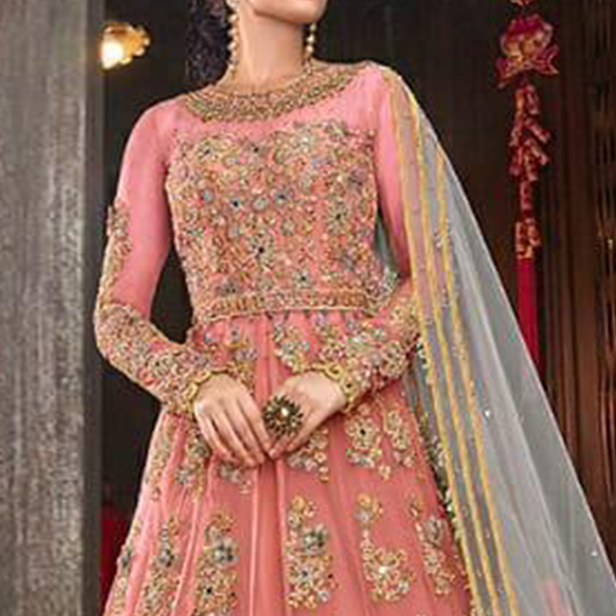 Magnetic Pink Colored Partywear Embroidered Netted Lehenga Anarkali