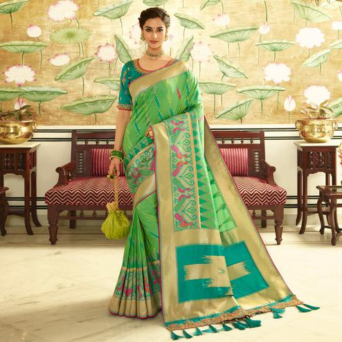 Radiant Green Colored Festive Wear Woven Silk Saree With Tassels