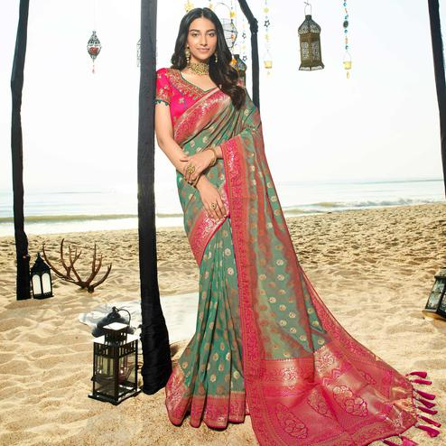 Adorning Green Colored Festive Wear Woven Jacquard Silk Saree With Tassels