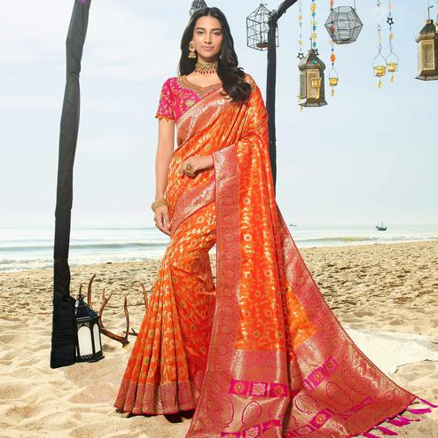 Engrossing Orange Colored Festive Wear Woven Jacquard Silk Saree With Tassels
