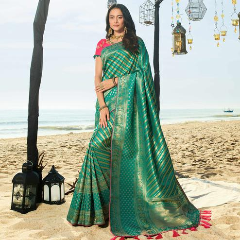 Captivating Green Colored Festive Wear Woven Jacquard Silk Saree With Tassels