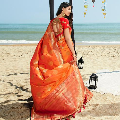 Amazing Orange Colored Festive Wear Woven Jacquard Silk Saree With Tassels