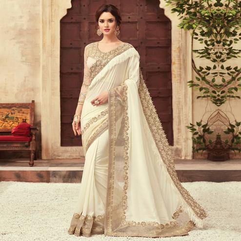 Arresting Off White Colored Party Wear Embroidered Silk Saree