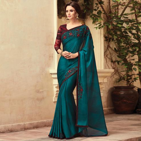 Exotic Teal Blue Colored Party Wear Embroidered Silk Saree