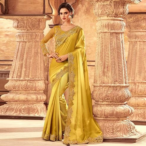 Arresting Yellow Colored Partywear Embroidered Silk Saree