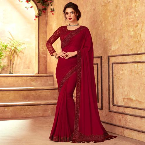 Mesmeric Maroon Colored Partywear Embroidered Georgette Saree