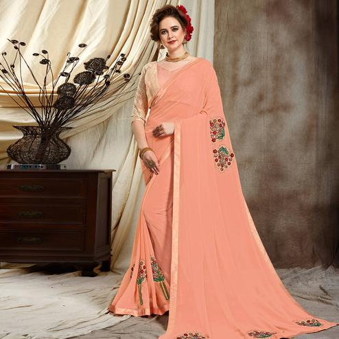 Intricate Peach Colored Partywear Embroidered Georgette Saree
