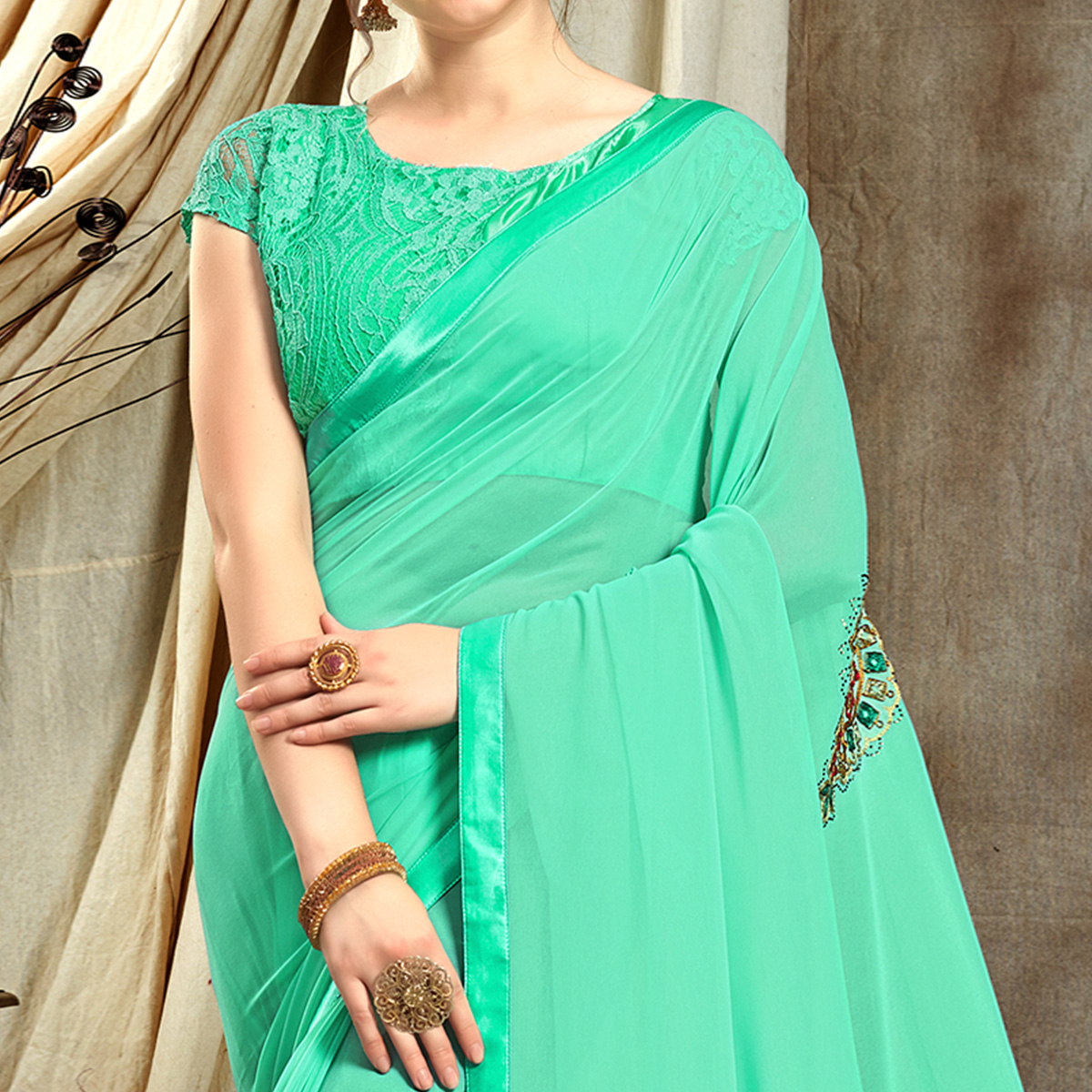 Exotic Aqua Blue Colored Partywear Embroidered Georgette Saree
