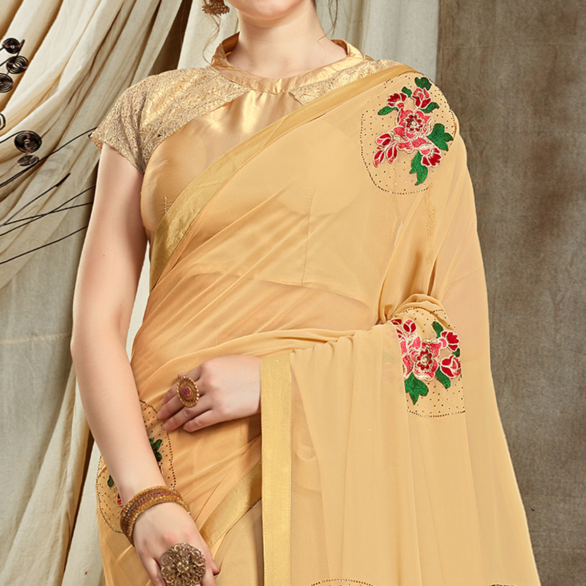 Sophisticated Cream Colored Partywear Embroidered Georgette Saree