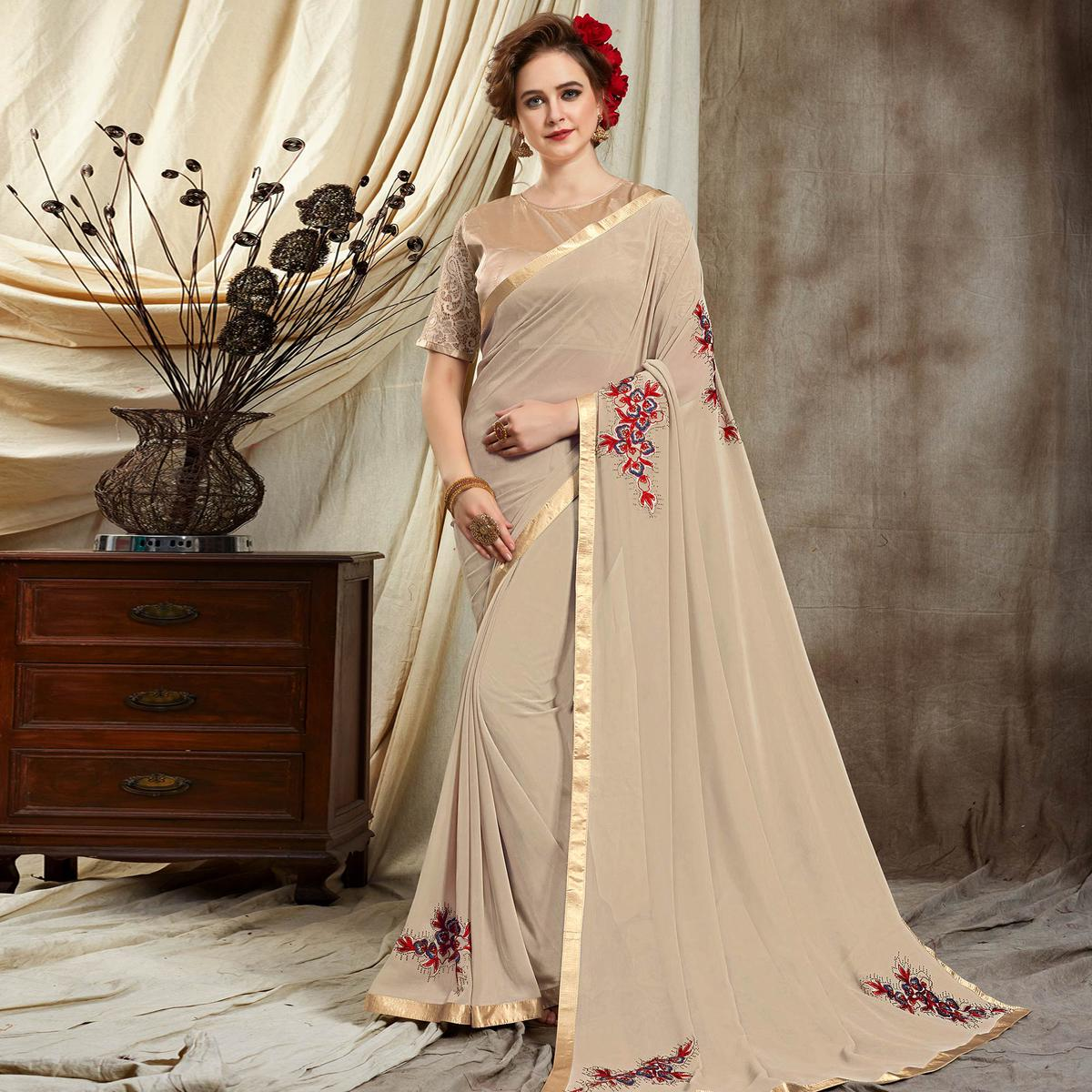Radiant Beige Colored Partywear Embroidered Georgette Saree