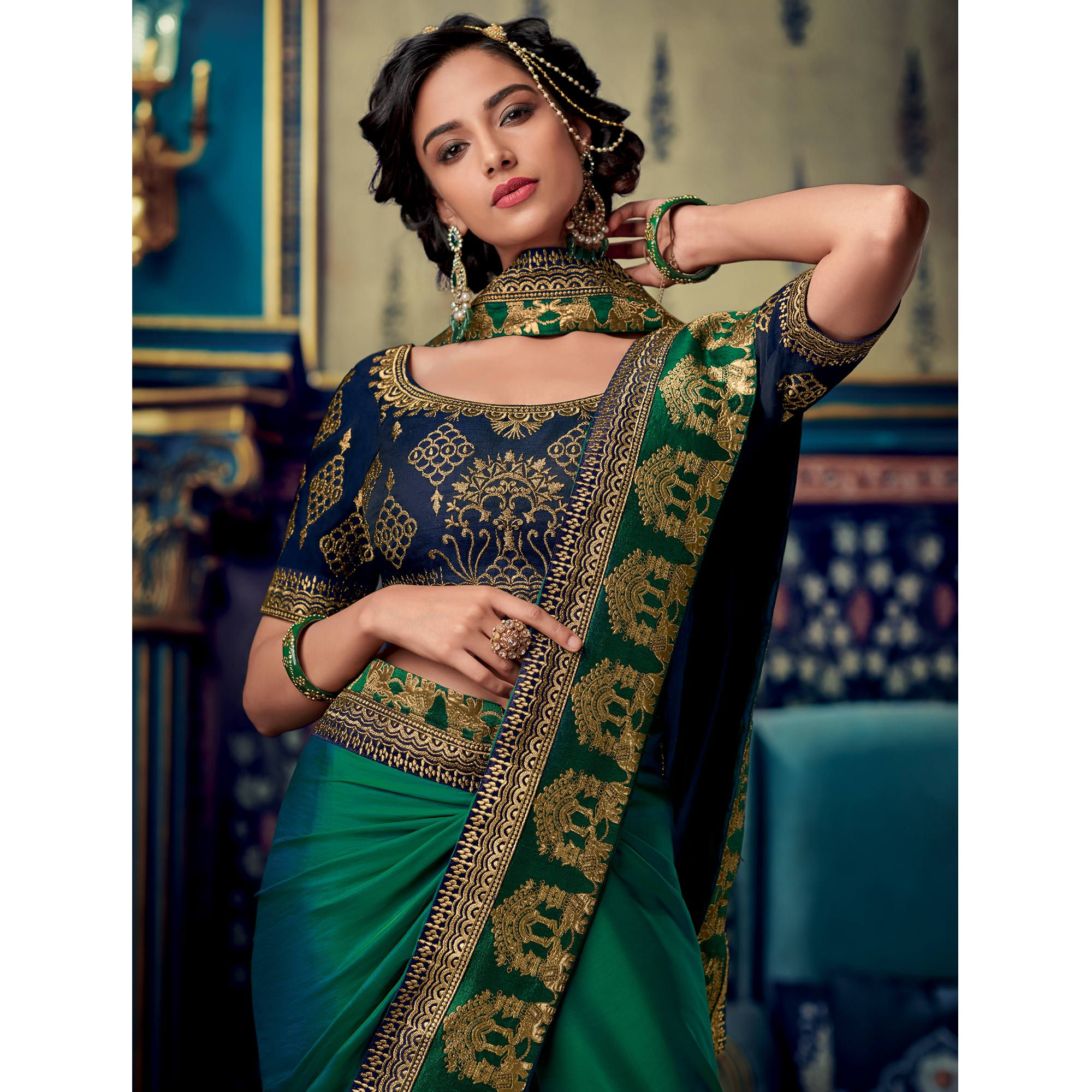 Gorgeous Green Colored Partywear Embroidered Silk Saree