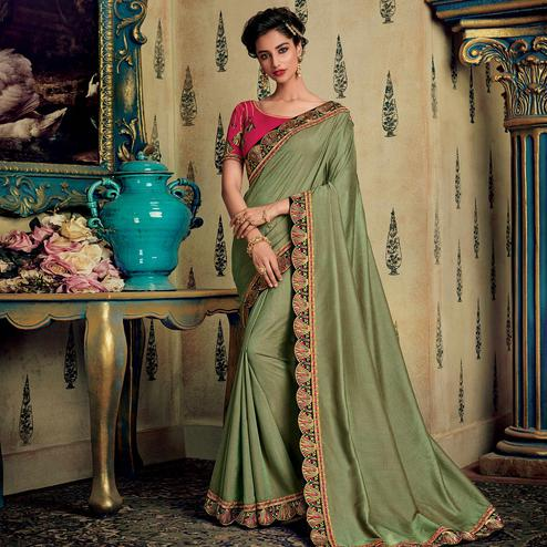 Dazzling Light Olive Green Colored Partywear Embroidered Silk Saree