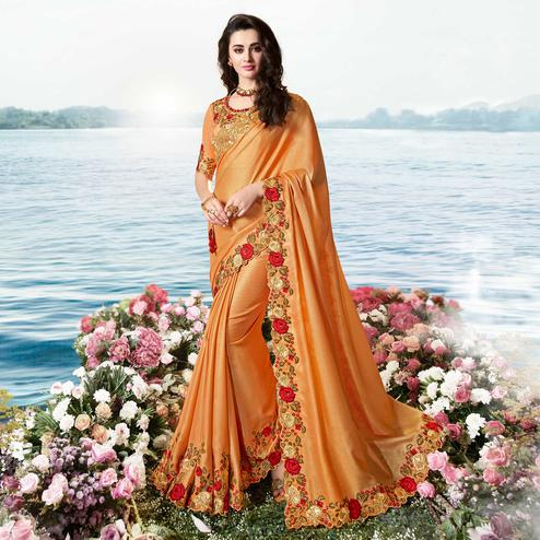Delightful Orange Colored Party Wear Floral Embroidered Silk Saree