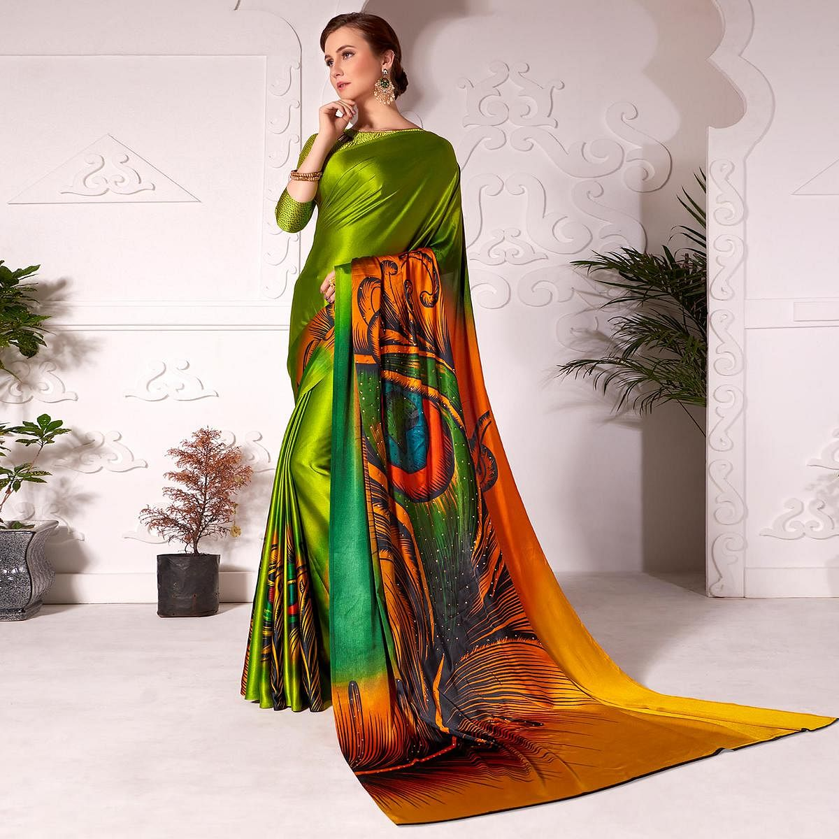 Flamboyant Olive Green Colored Partywear Peacock Feather Printed Satin Saree