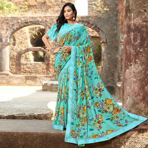 Graceful Aqua Green Colored Casual Floral Printed Georgette Saree
