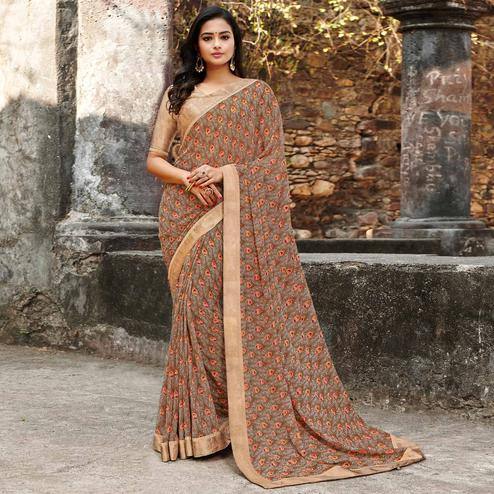 Engrossing Brown Colored Casual Floral Printed Georgette Saree