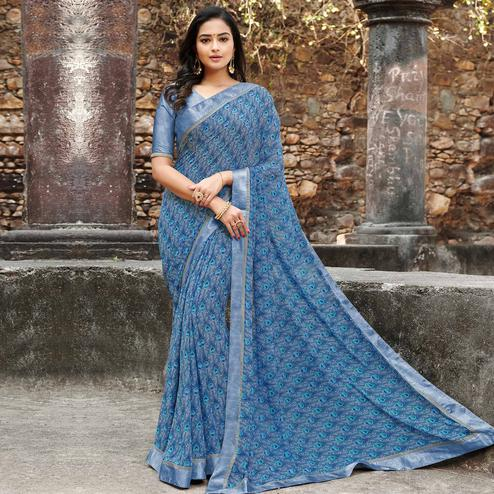 Captivating Blue Colored Casual Floral Printed Georgette Saree
