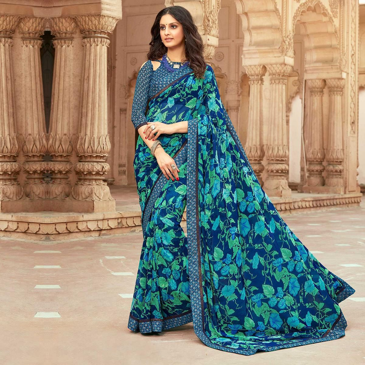 Prominent Blue Colored Casual Floral Printed Georgette Saree