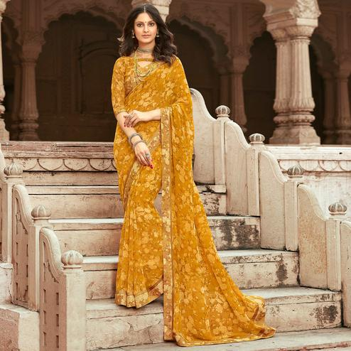 Appealing Mustard Yellow Colored Casual Floral Printed Georgette Saree