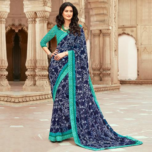 Entrancing Navy Blue Colored Casual Floral Printed Georgette Saree