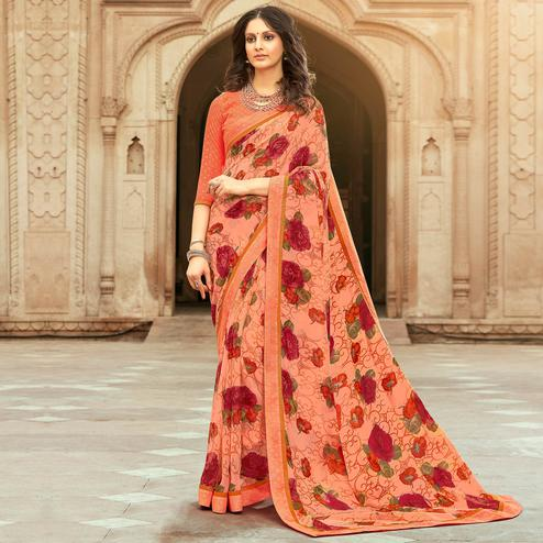 Exclusive Peach Colored Casual Floral Printed Georgette Saree