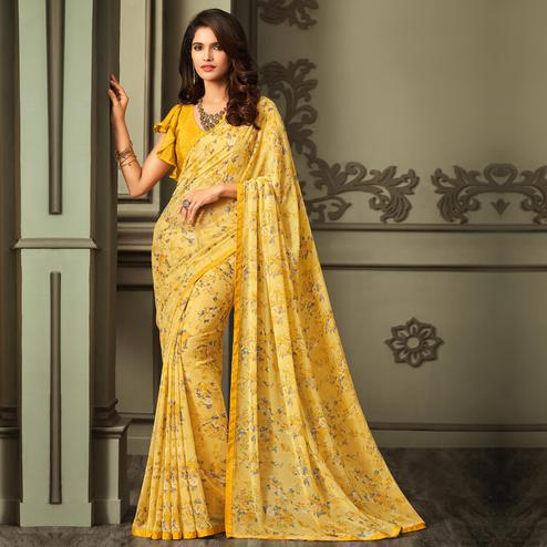 Innovative Yellow Colored Casual Floral Printed Georgette Saree