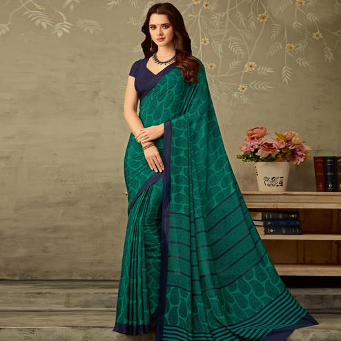 Gorgeous Turquoise Green Colored Partywear Printed Silk Crepe Saree