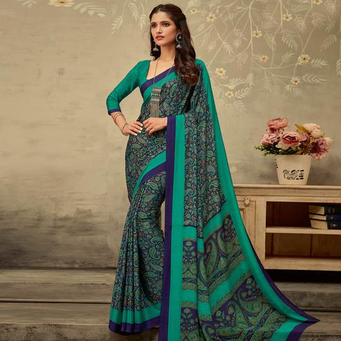 Lovely Blue Colored Partywear Printed Silk Crepe Saree