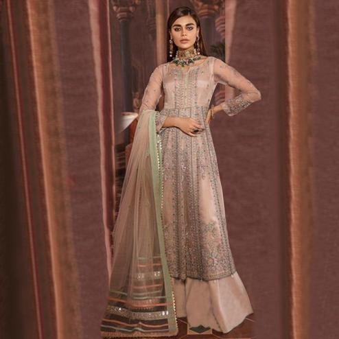 Excellent Beige Colored Partywear Embroidered Netted Suit
