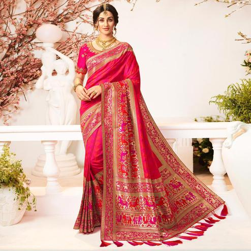 Intricate Pink Colored Festive Wear Woven Banarasi Silk Saree With Tassels