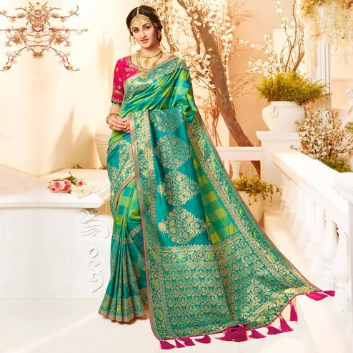 Exotic Blue & Green Colored Festive Wear Woven Banarasi Silk Saree With Tassels
