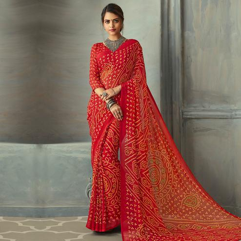 Intricate Red Colored Casual Wear Bandhani Printed Chiffon Saree