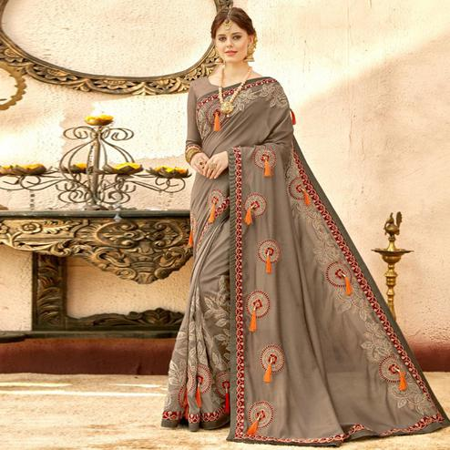 Intricate Light Brown Colored Party Wear Embroidered Art Silk Saree With Tassels