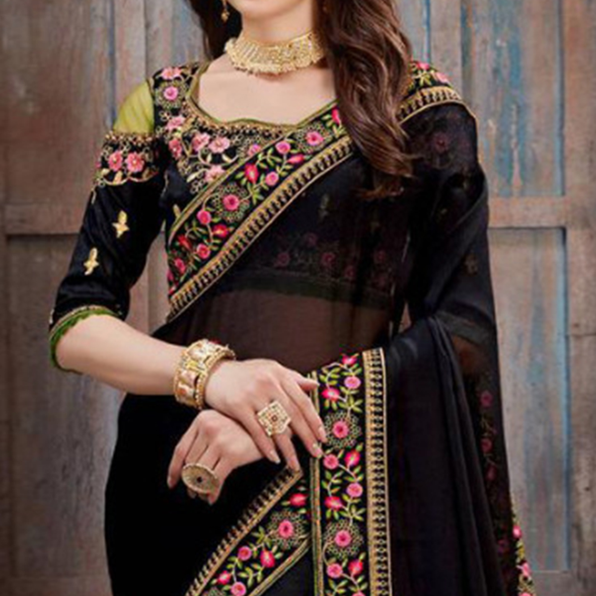 Unique Black Colored Party Wear Floral Embroidered Georgette Saree