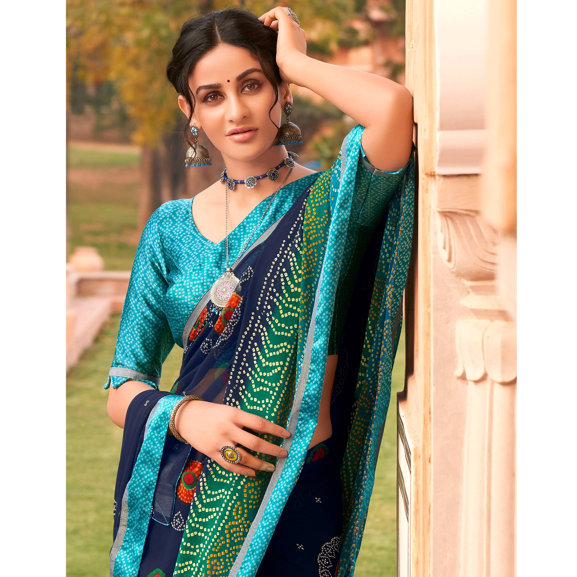 Beautiful Blue Colored Casual Wear Bandhani Printed Georgette Saree
