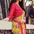 Lovely Yellow Colored Partywear Designer Printed Georgette Saree