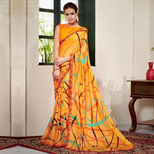 Trendy Orange Colored Casual Wear Printed Chiifon-Georgette Saree
